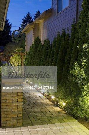Backyard Garden Pavers Path Brick Column with Bronze Crane at Night