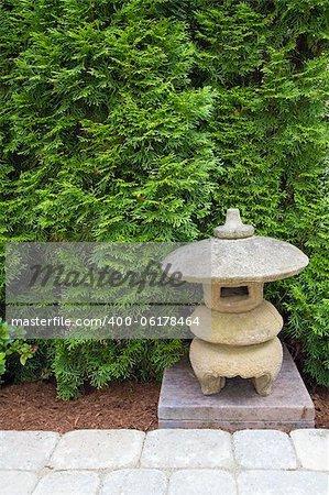 Japanese Stone Pagoda in Backyard Garden Paver Patio