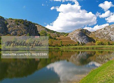 Mountain lake with a blue sky