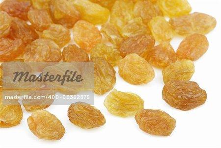 Heap of yellow raisin isolated on white background