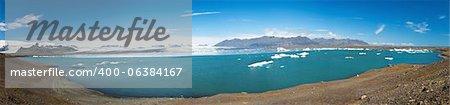 Beautiful panoramic photo of Jokulsarlon Glacial lake full of floating icebergs