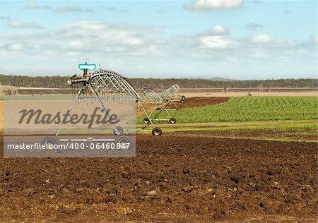 Australian agriculture scene rural irrigation on sugar cane farm ploughed land
