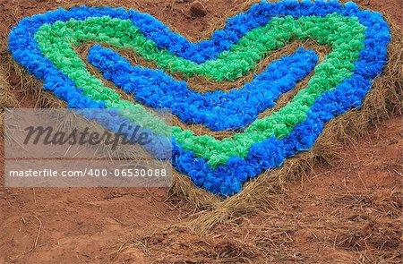 symbol of love - colour full heart on soil  background