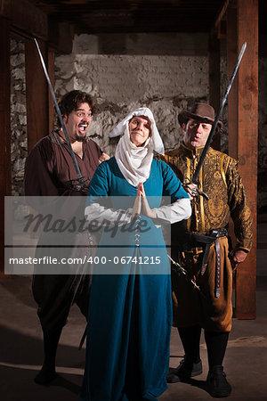 Two renaissance character men teasing righteous nun