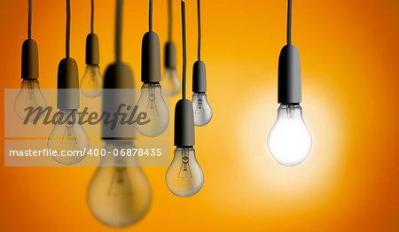 Light bulb lighting up against orange background