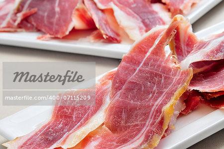 closeup of a some spanish serrano ham tapas, on a table