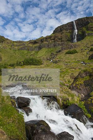 Beautifull small waterfall on Iceland and a brook. Snaefellsness peninsula