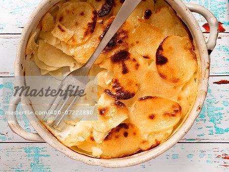 close up of a bowl of rustic potato gratin