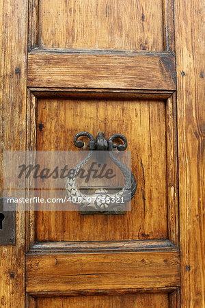 The door knocker  and handle on an medieval door