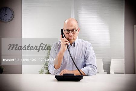 bald clerk staring at you perplexed