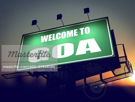 Welcome to Goa - Green Billboard on the Rising Sun Background.