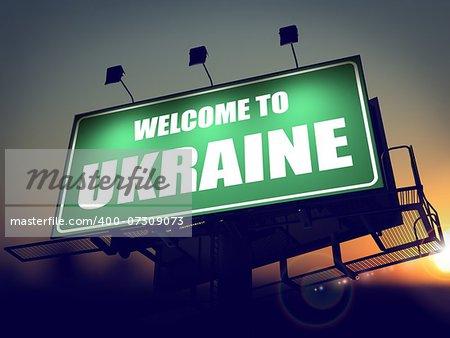 Welcome to Ukraine - Green Billboard on the Rising Sun Background.