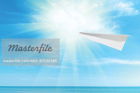 paper plane against beautiful blue Caribbean sky, sea and sun