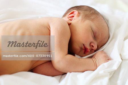Cute three-day old baby boy asleep