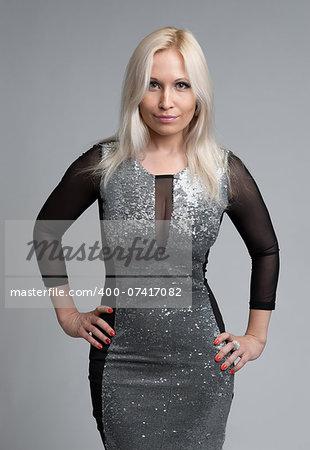 Portrait of beautiful blonde woman. Gray background