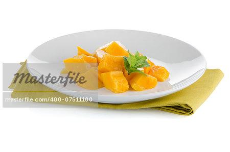 Mango fruit on white plate on white background.