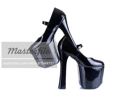 Black fetish style high heel shoes, isolated on white background