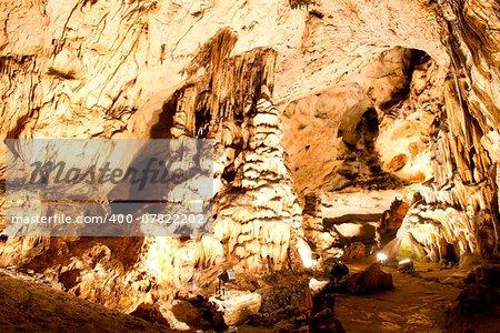 Beautiful cave with many stalagmites and stalactites inside
