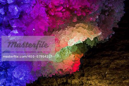 Illuminated and colorful rock crystal. Mlynky Cave, Ukraine
