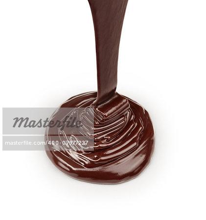 stream of dark chocolate isolated on white background