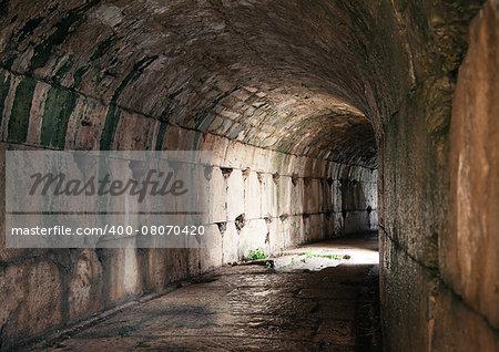 Narrow corridor in an ancient greek amphitheater