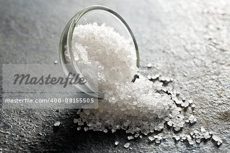 white salt on black kitchen table