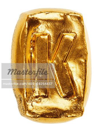 Handmade ceramic letter K painted in gold isolated on white