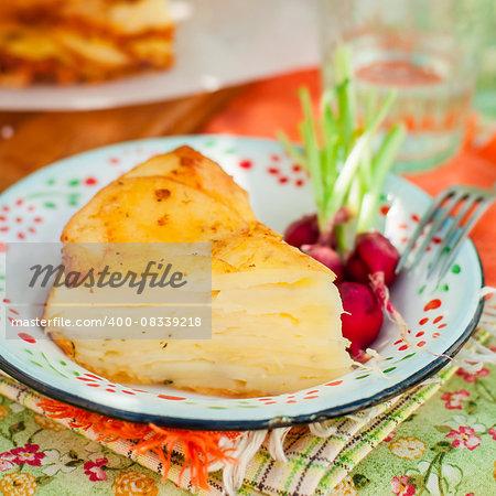 A Slice of Upside Down Layered Potato Bake (Cake), square