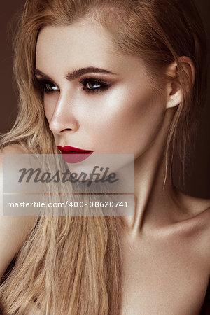Beautiful sexy blonde girl with sensual lips, fashion hair, black art nails. Beauty face. Photo shot in studio