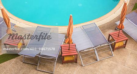 top view of beautiful swimming pool. beautiful swimming pool in the tropics Resort.