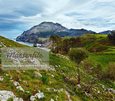 Spring sea coast lanscape with rocky cape and small bay (San Julian Beach, Liendo, Cantabria, Spain).