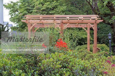 Wood Arbor in home garden backyard lush landscaping