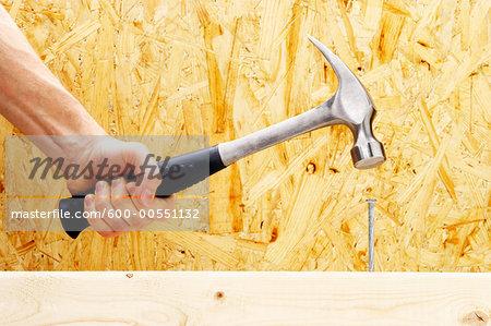 Hand Hammering Nail