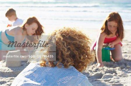 Family on the Beach, Children Making Sandcastles