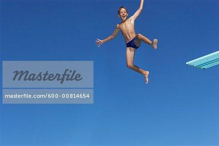 alivio insuficiente eso es todo  Boy Diving - Stock Photo - Masterfile - Premium Royalty-Free, Artist:  Masterfile, Code: 600-00814654