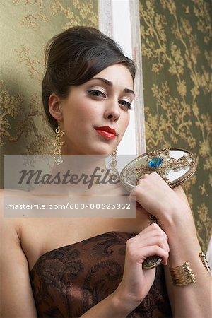 Portrait of Woman Holding Mirror Stock Photo Masterfile