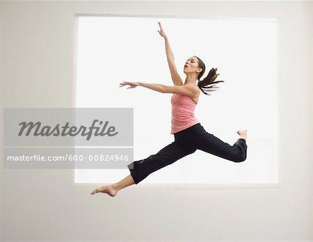 Ballet Dancer Jumping in Air