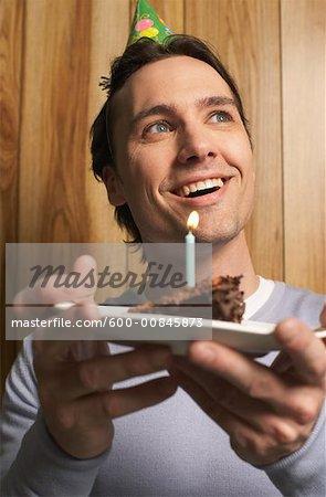 Man Holding Birthday Cake