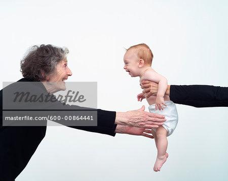 Woman Reaching for Grandchild