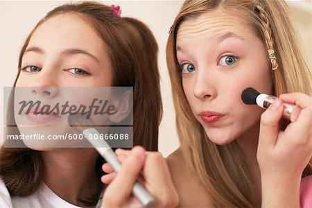 Girls Applying Make-up