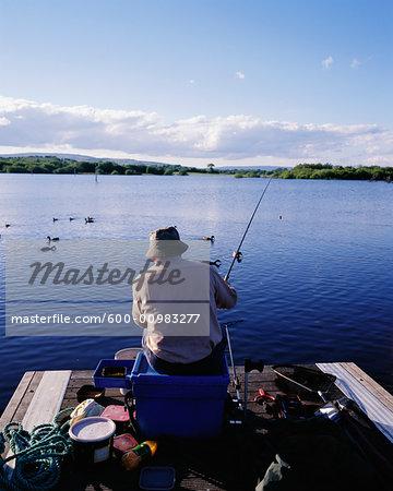 Man Fishing Off Dock, Port at Drumshanbo, Lough Allen, Leitrim, Ireland