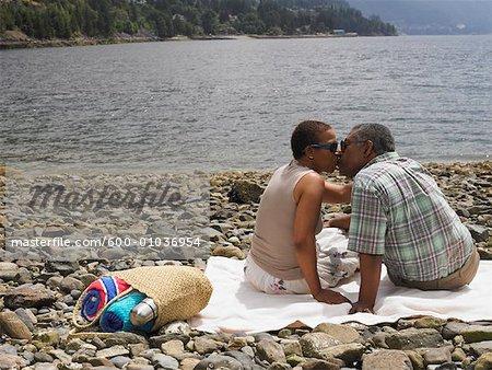 Couple Kissing on Shore