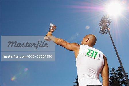 Champion Athlete Holding Trophy