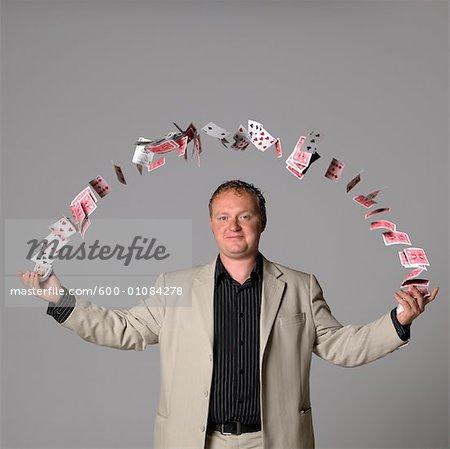 Man Juggling Playing Cards