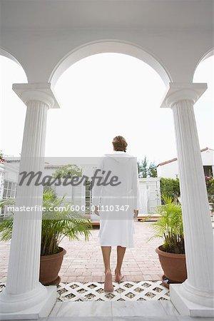 Man Walking onto Patio