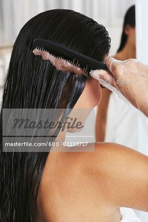 Woman Applying Hair Coloring