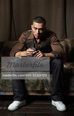 Man Dialing Cellular Phone
