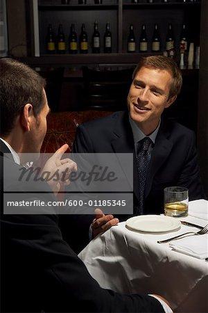 Men Talking Over Drinks