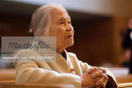 Woman Praying Inside Church