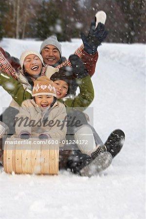 Family on Toboggan, Whistler, British Columbia, Canada